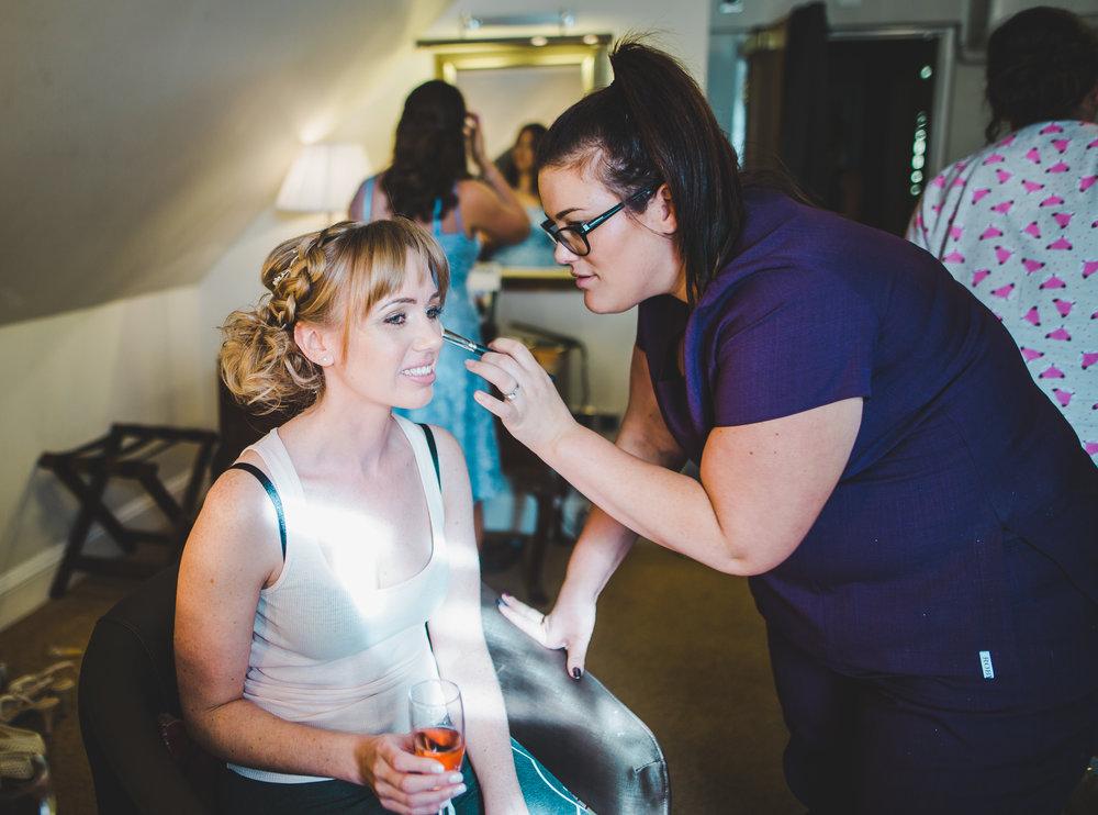 bride having her make up done.