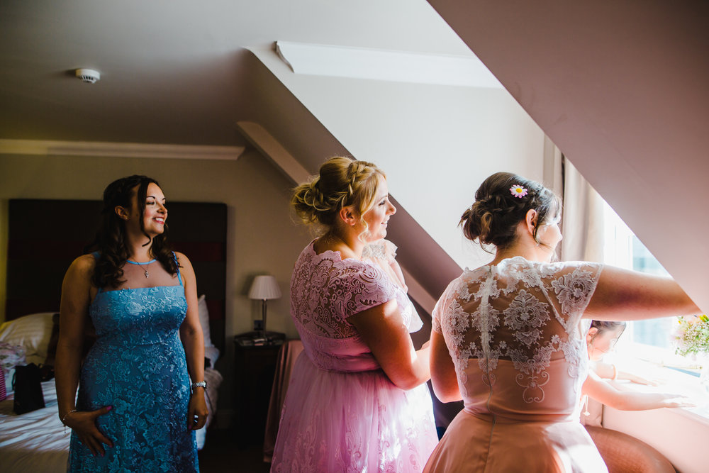 bridesmaids in mismatched dressed - pastel themed wedding day.