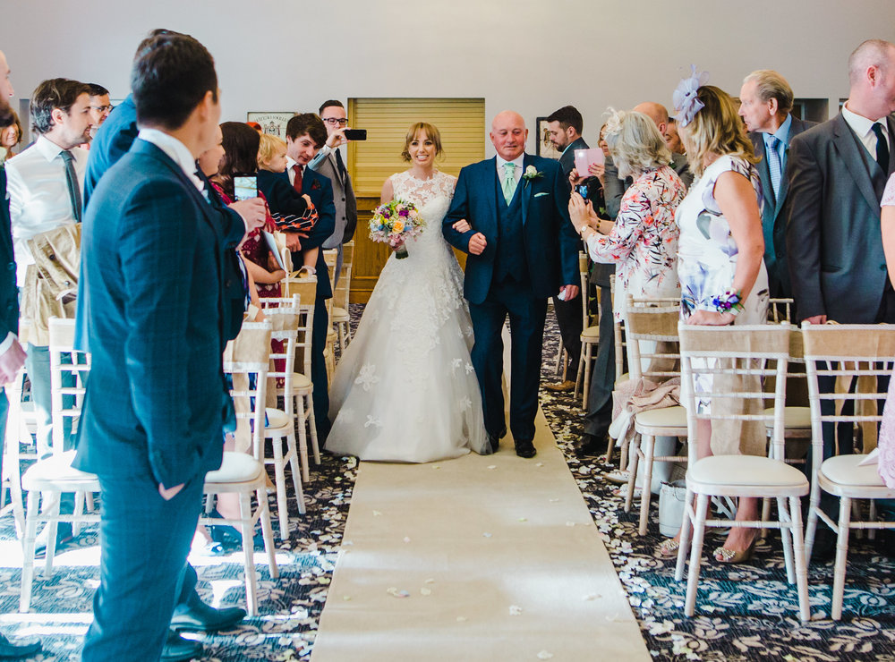 bride walks down the aisle - wedding ceremony at The Villa at Wrea Green