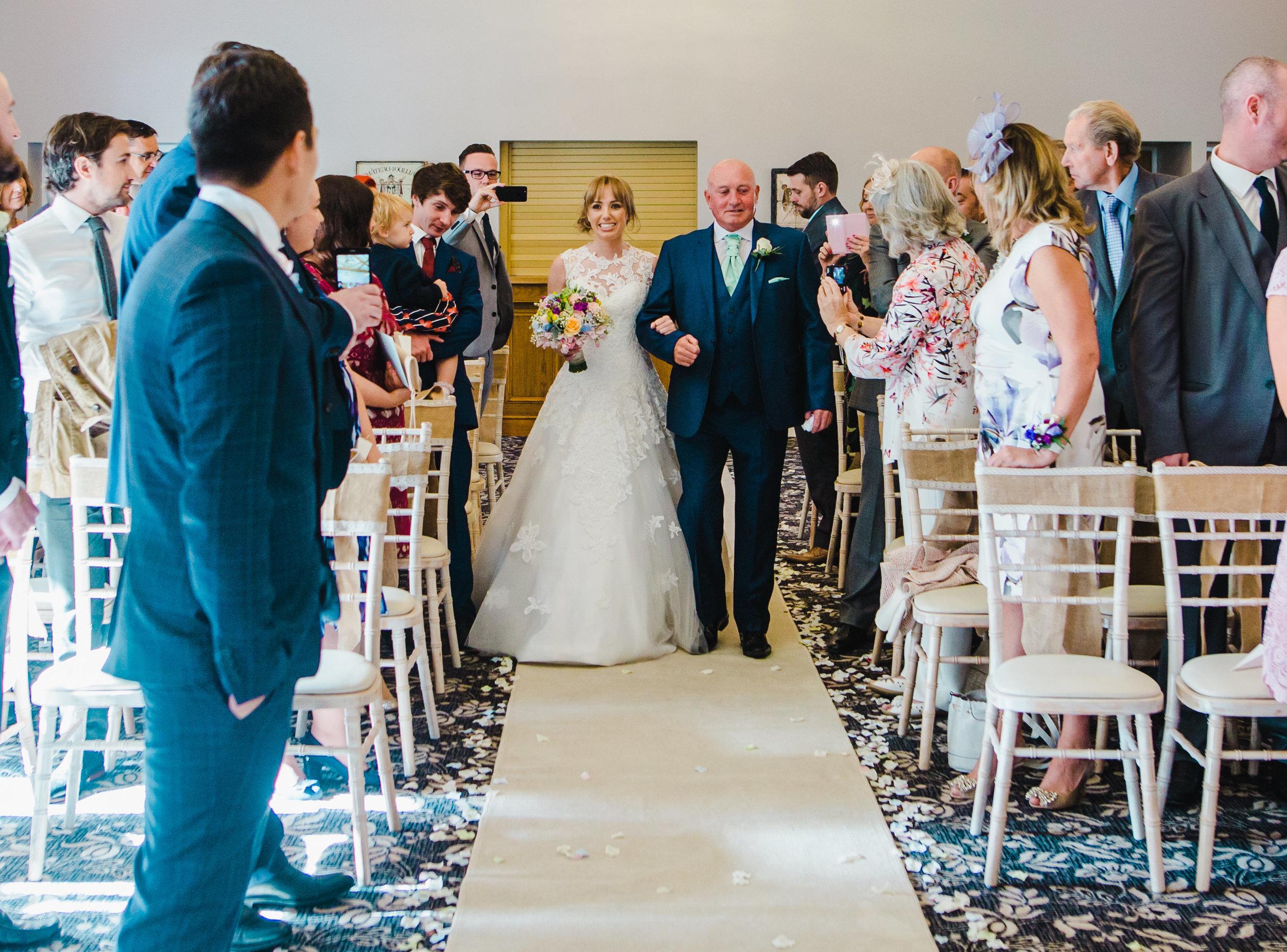 bride walks down the aisle - Villa at Wrea Green Wedding