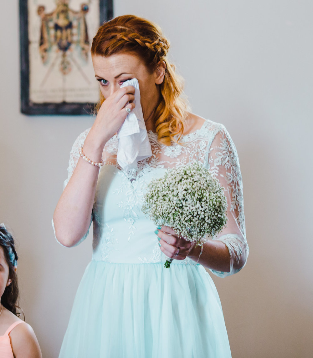 bridesmaid getting emotional during the wedding ceremony - Documentary wedding photography in Lancashire.