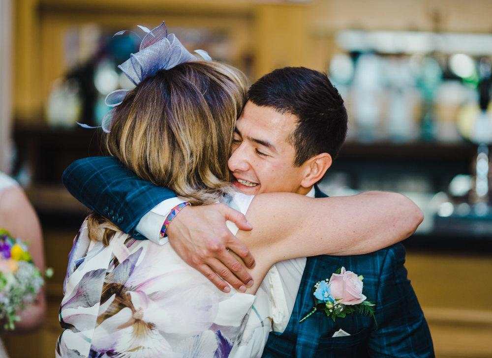groom hugs a guest