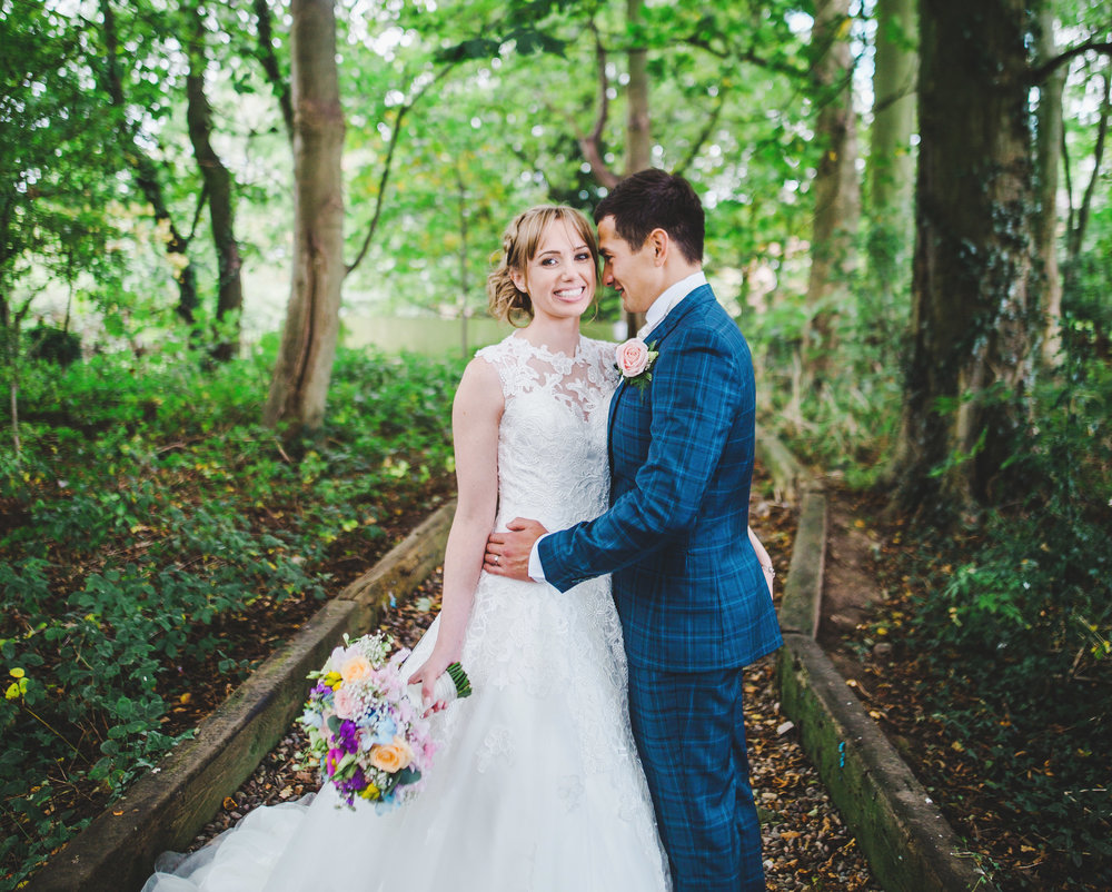 Bride and groom portraits in the woods outside the Villa at Wrea Green