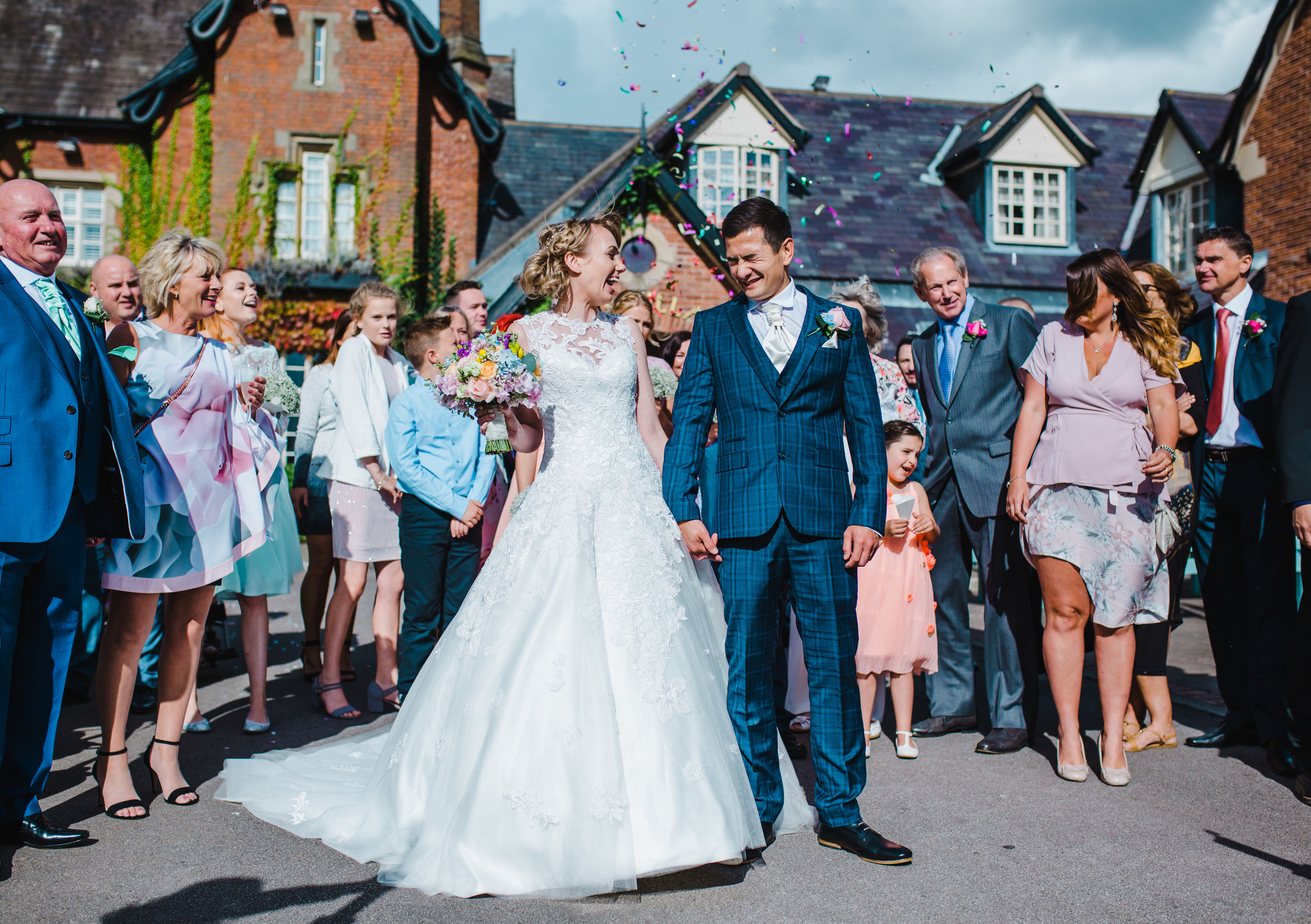 confetti in the face - Lake District wedding photographer
