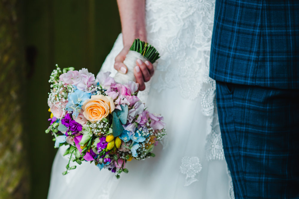 a close up of the brides colourful flowers