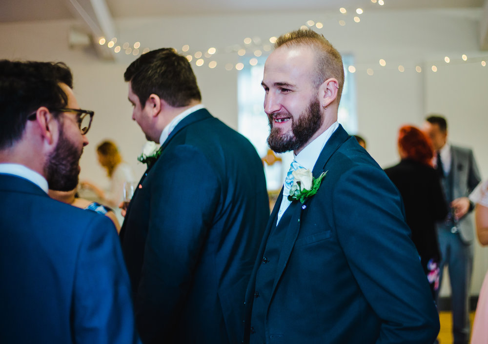documentary photographs of the guests laughing - wedding photographers Lancashire
