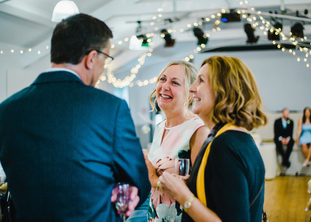 brides mum laughs with guests