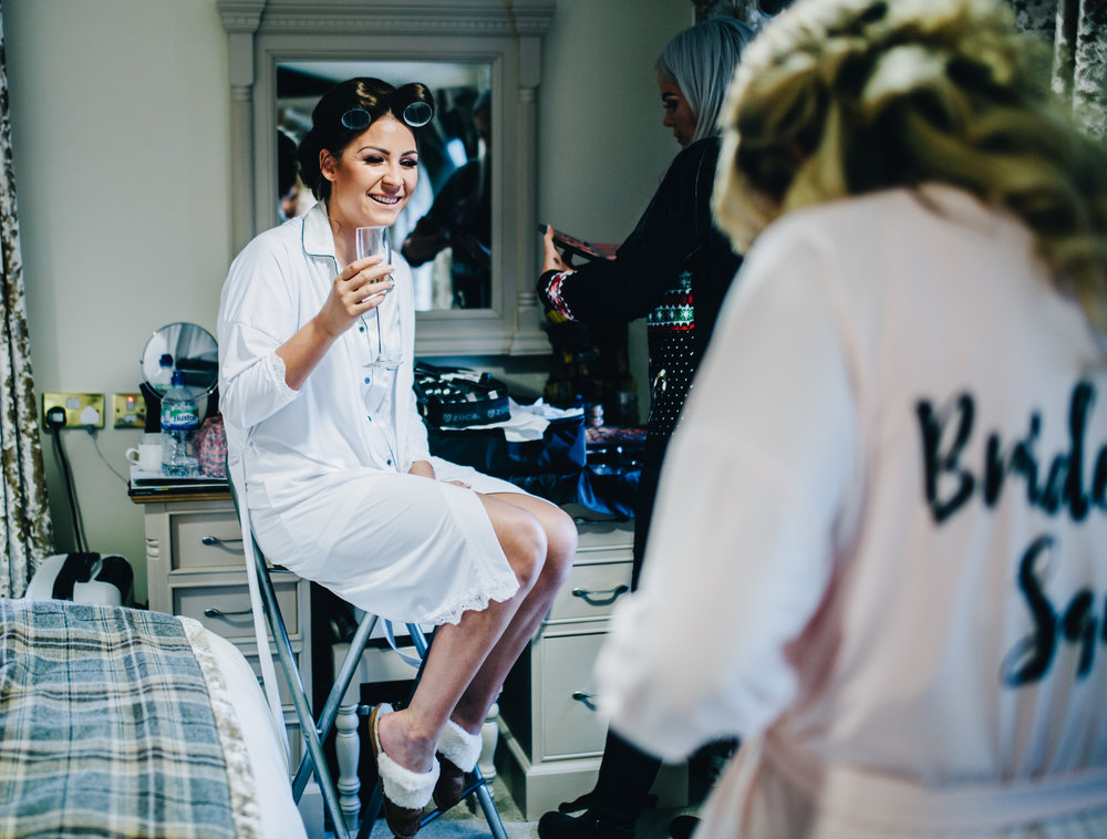 bride and bridesmaids getting ready for the wedding at the alma inn in Lancashire