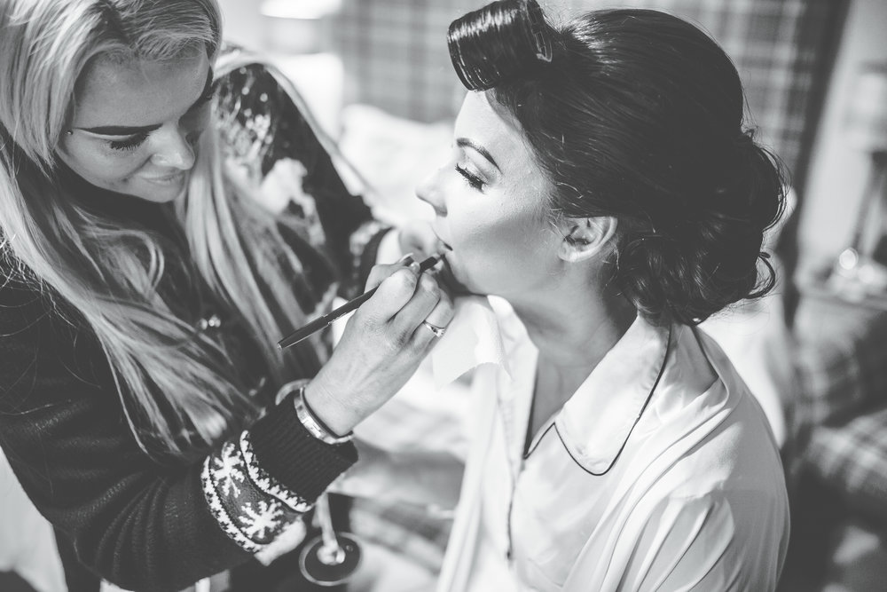 close up of bride having her wedding make up applied