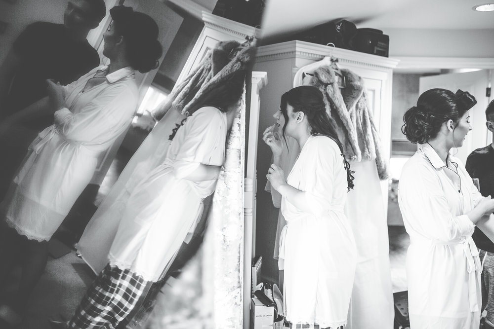 creative black and white images from lancashire wedding - bridesmaid looking in mirror