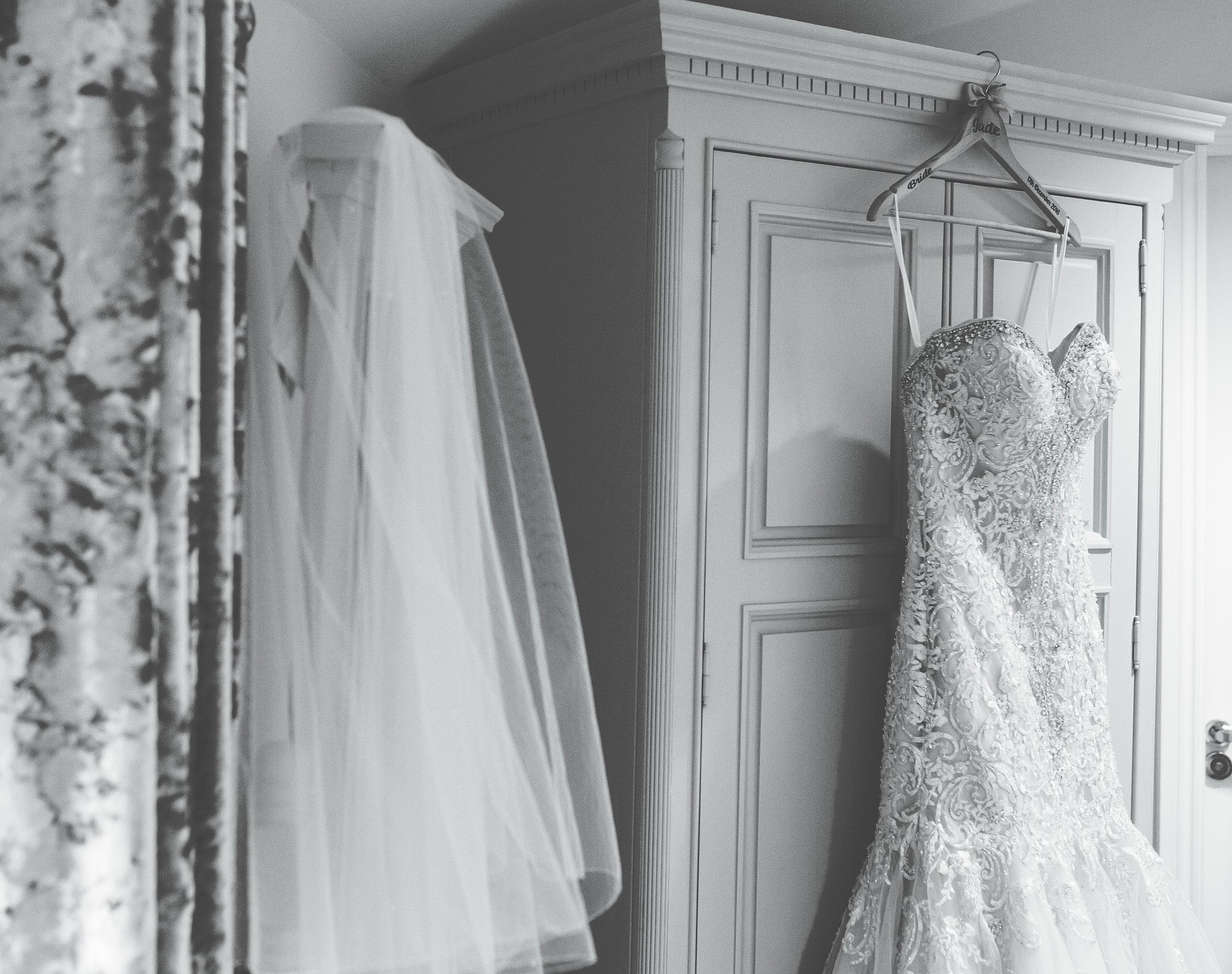 bride's dress hanging - alma inn.