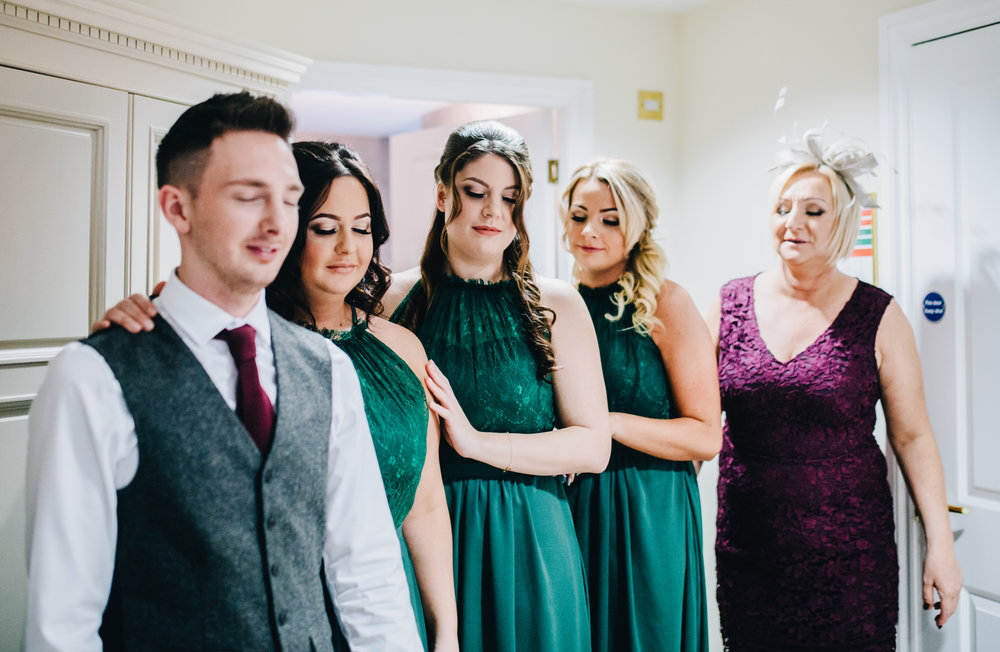 bridesmaids wait to see the bride for the first time