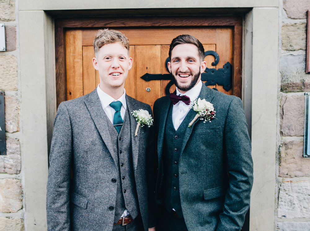 groom and his best man standing outside the Alma Inn in Lancashire