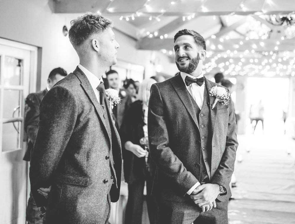 groom and his best man laughing together