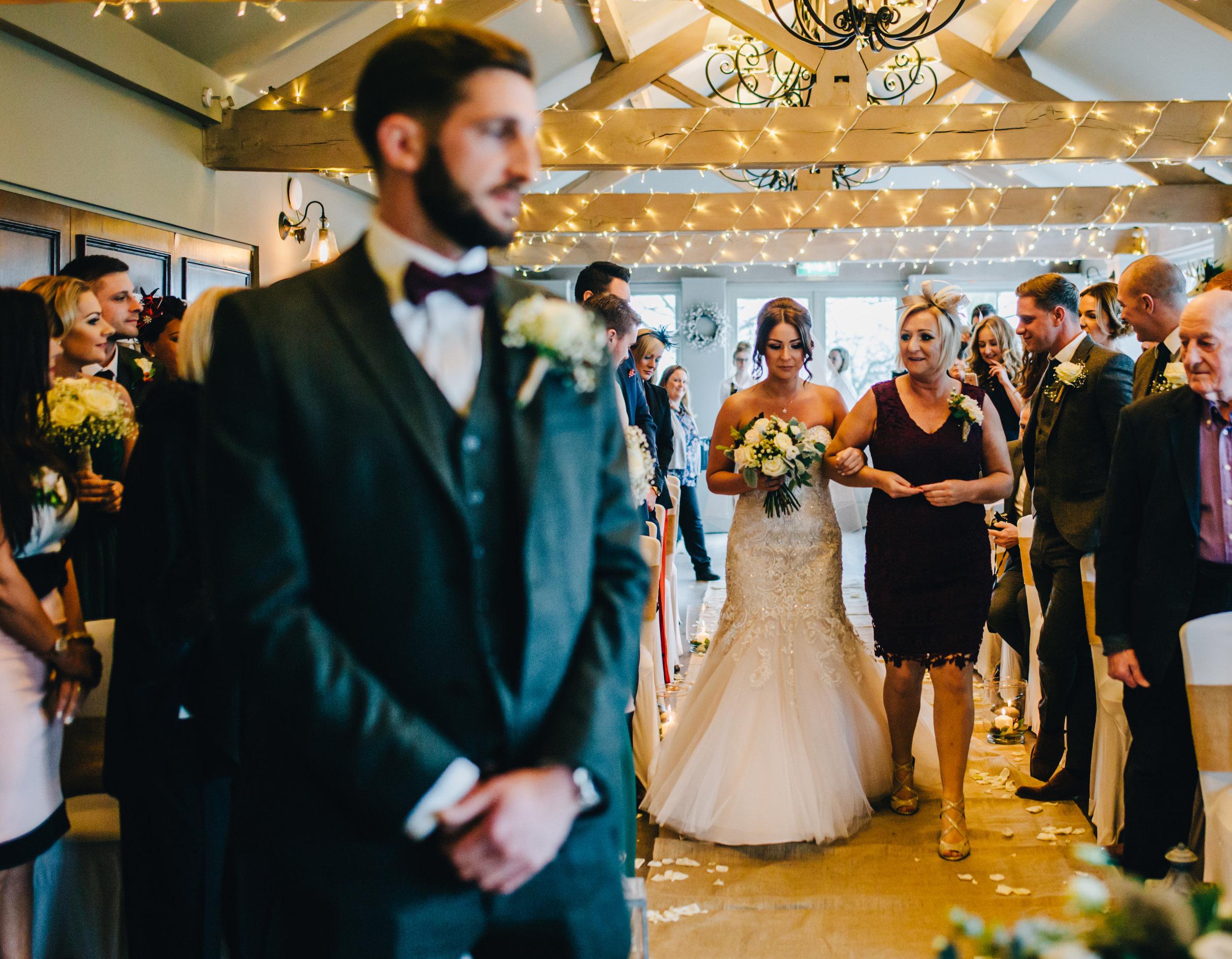 bride walks down the aisle - alma inn wedding