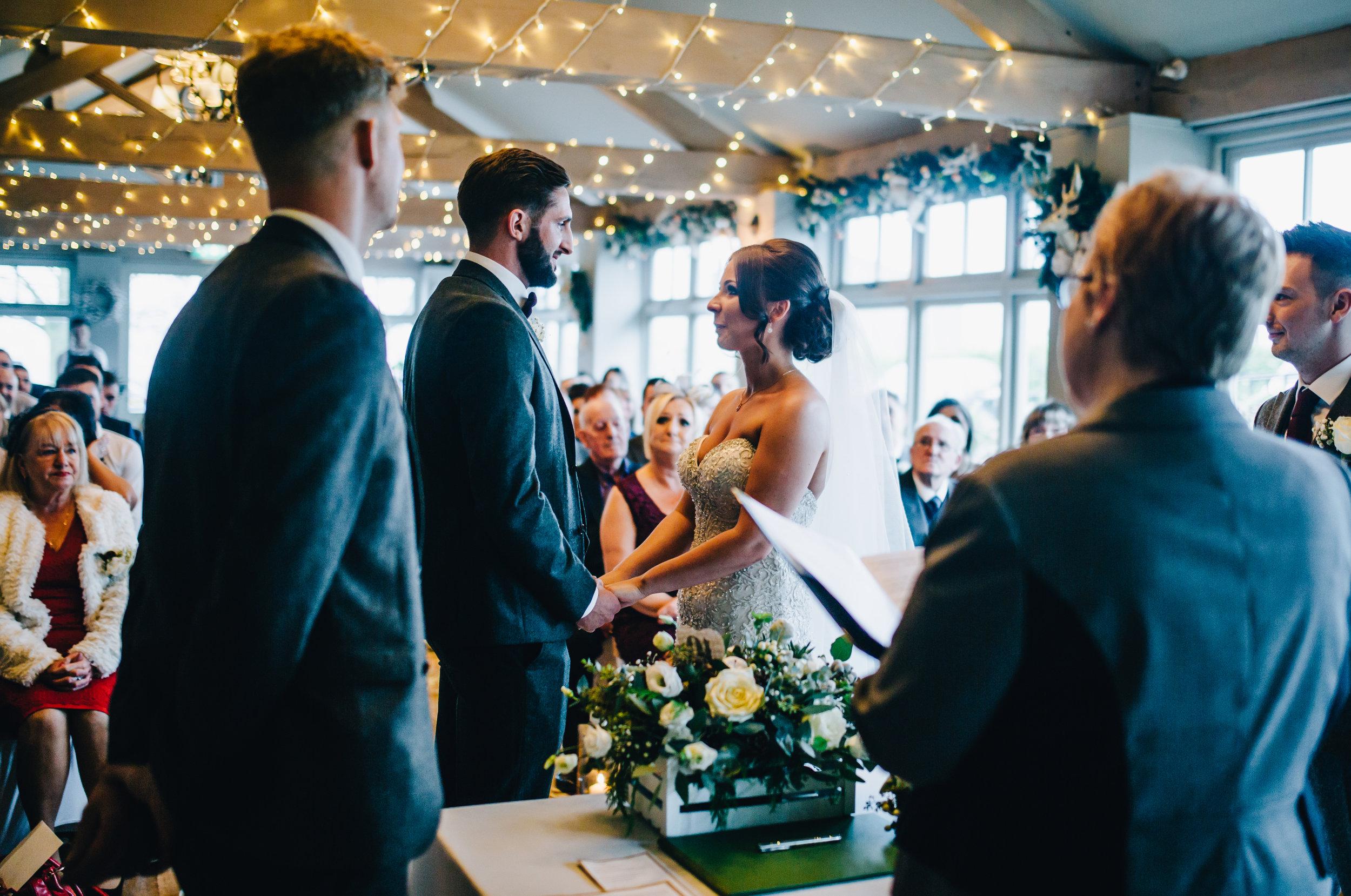 bride and groom exchange vows - Alma Inn wedding