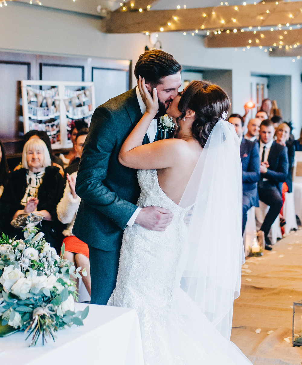 bride and groom share first kiss at the Alma Inn Lancashire