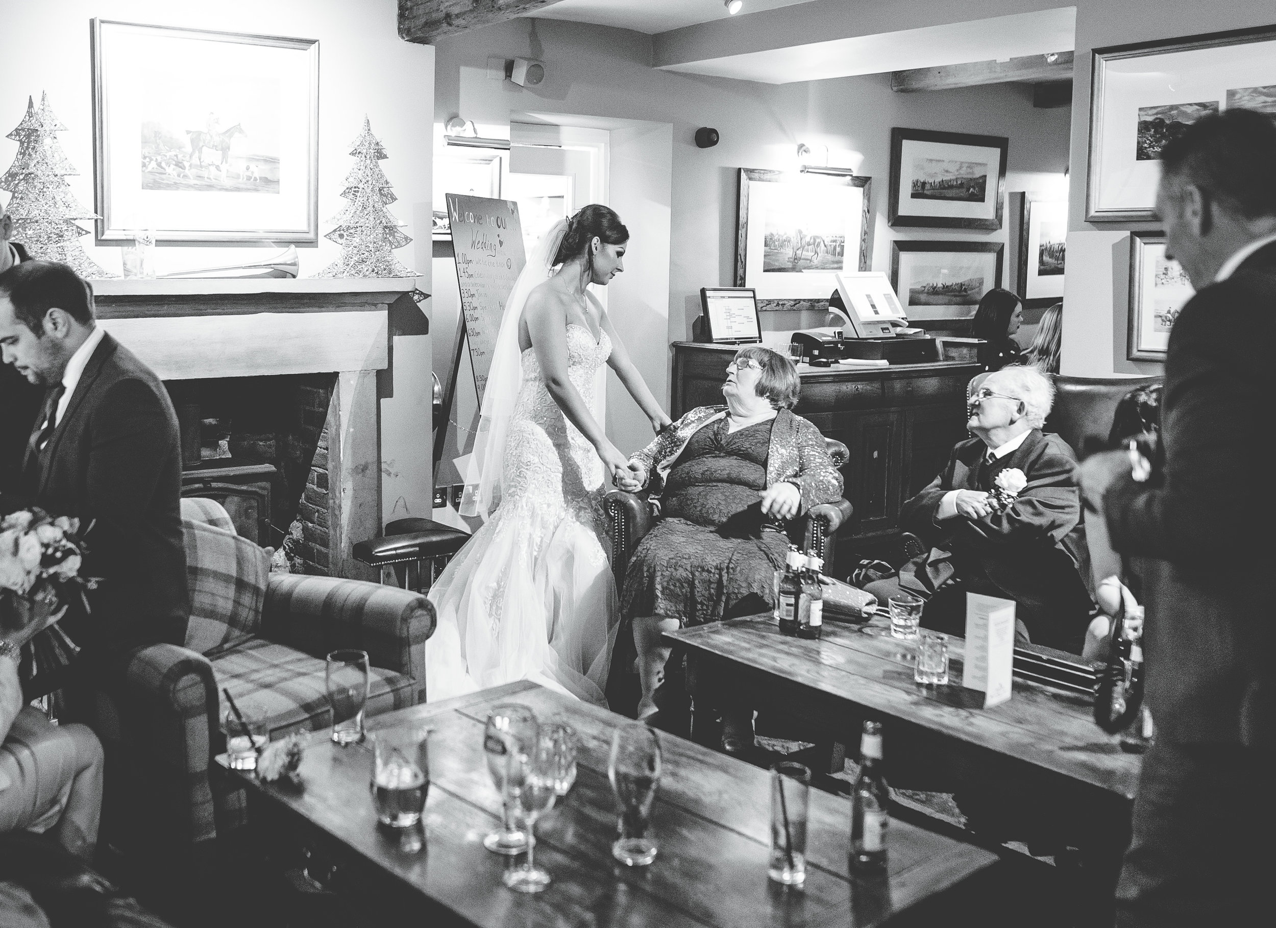 bride with guests - Lancashire wedding photography