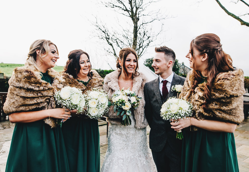 winter wedding inspiration - bridesmaids in green dresses and shrugs