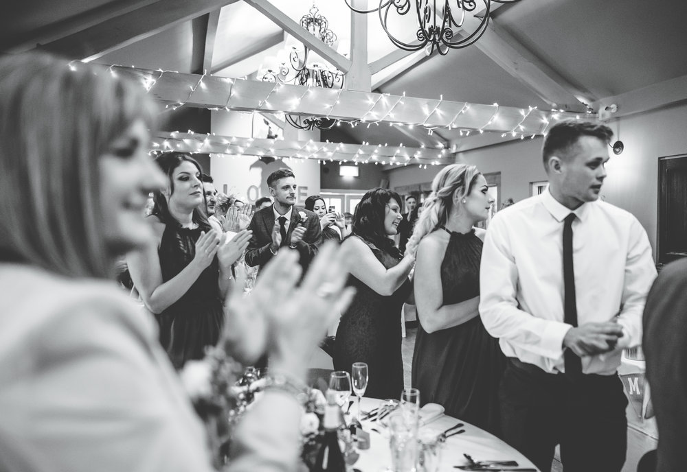 guests claps at the newlyweds walk in the room