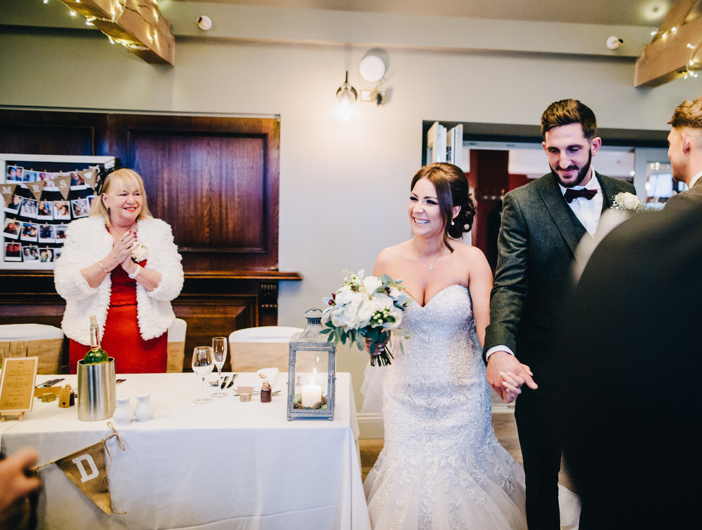 bride and groom walk into the ceremony room at the Alma Inn