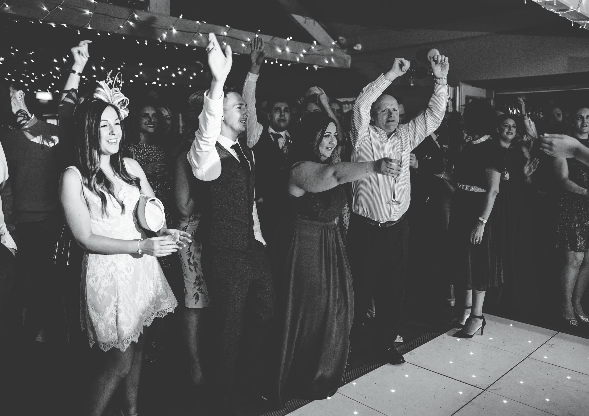 guests get excited on the dance floor