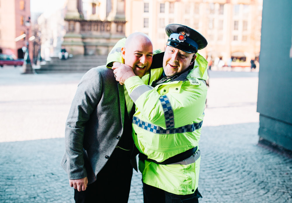groom in headlock with policeman