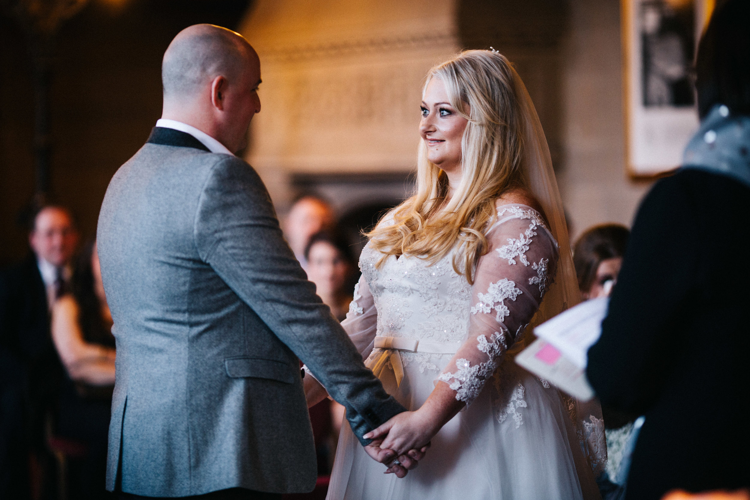 exchanging vows - wedding photography North West