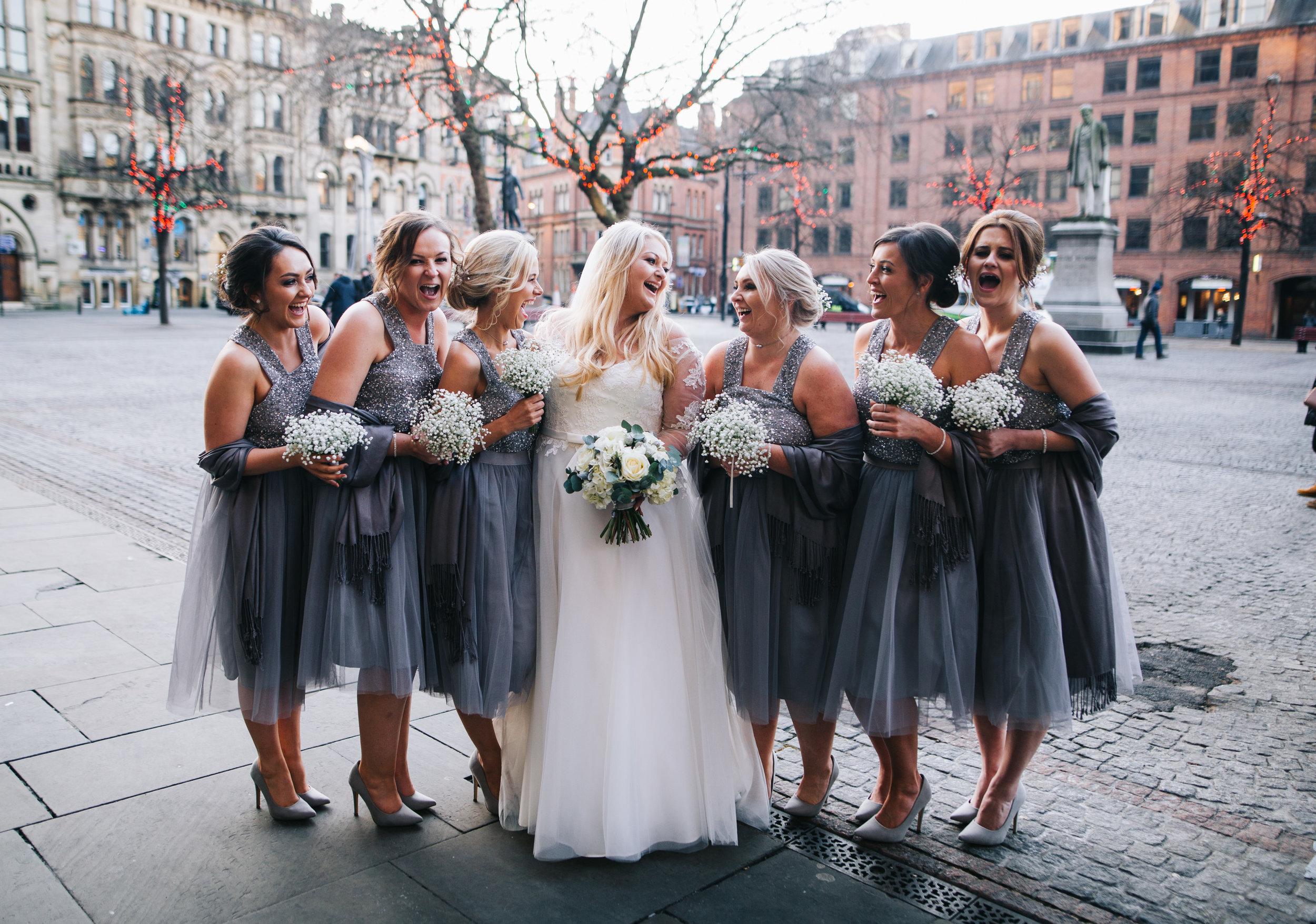 winter wedding Manchester - bride and bridesmaid