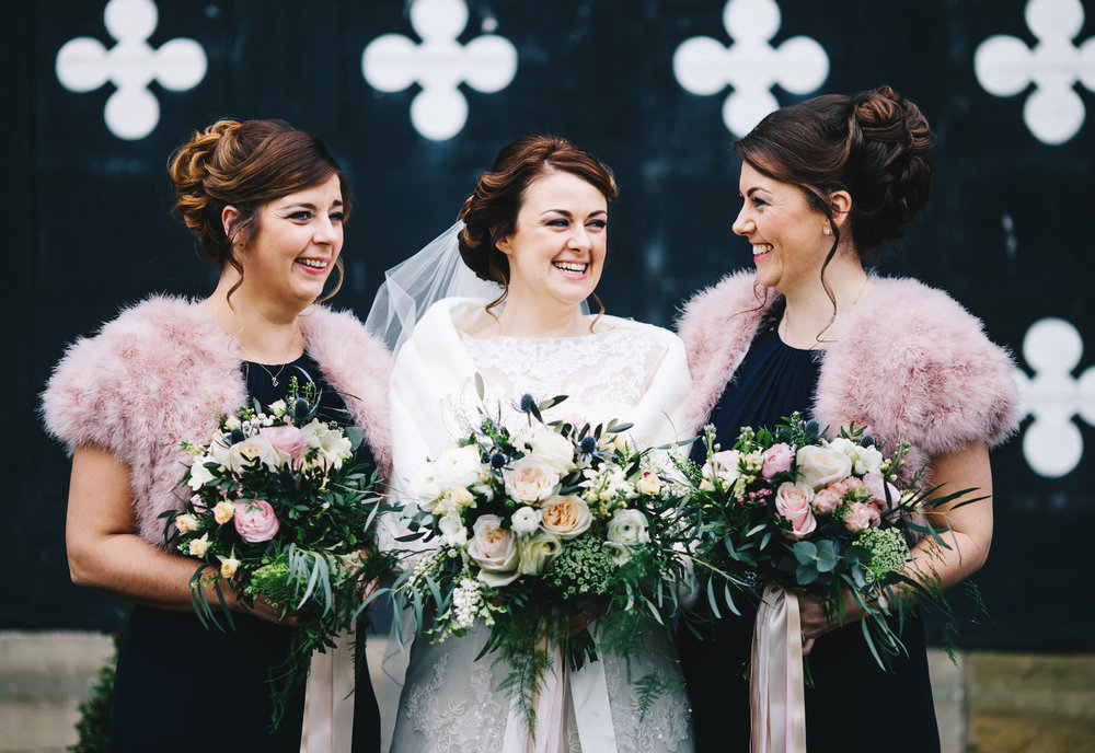 bride and her bridesmaids laughing - winter wedding in lancashire