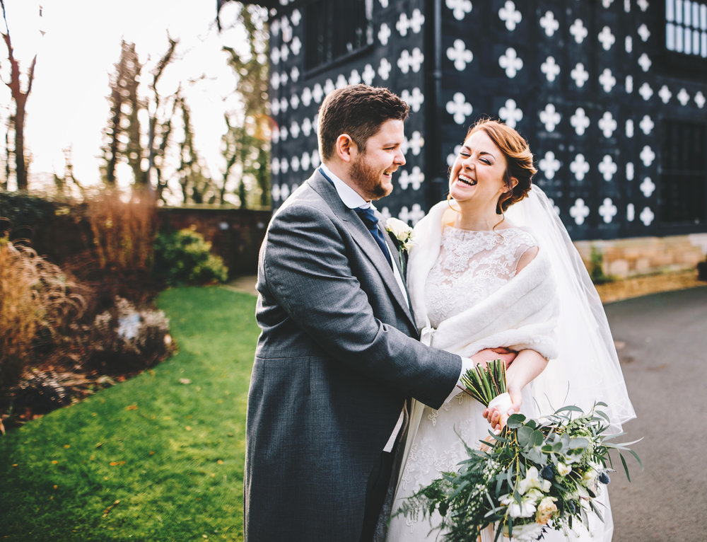 creative wedding pictures at samlesbury hall - bride and groom laugh with each other