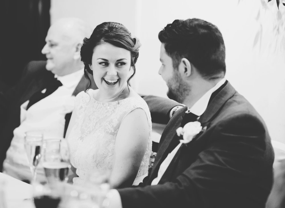 authentic documentary wedding images - couple laugh during the speeches
