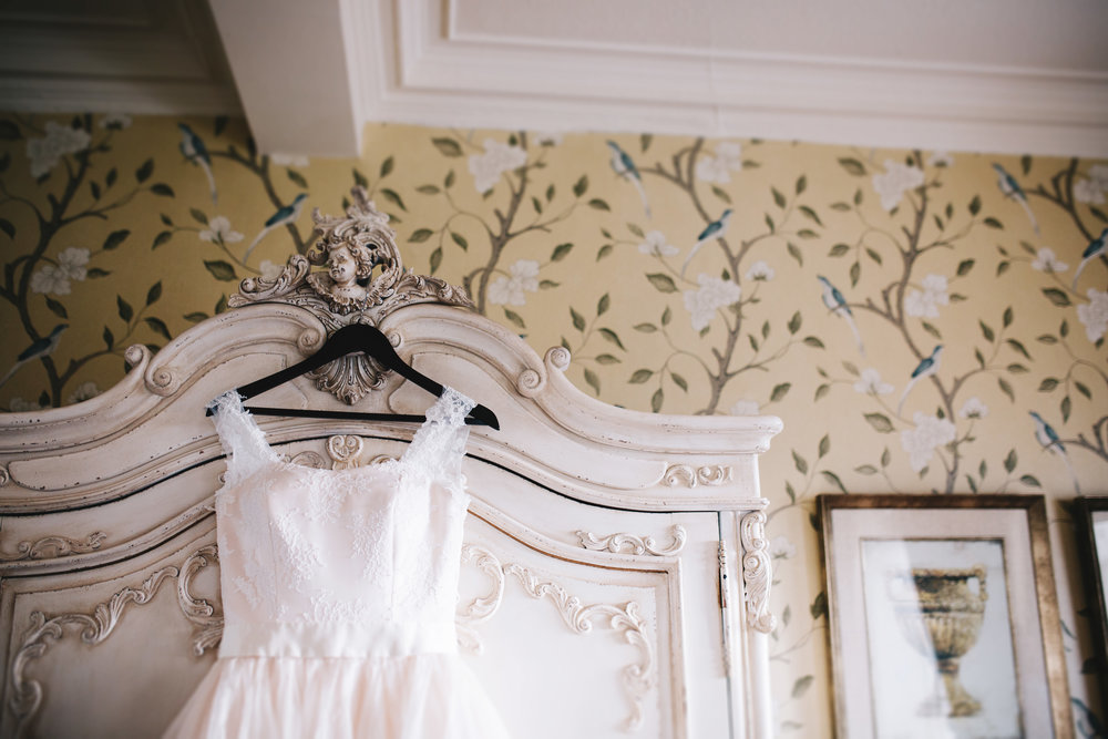 documentary wedding photography at Eaves Hall - the bride's dress hanging up