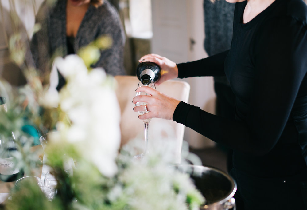 close up of champagne being poured - relaxed wedding pictures from EAves Hall