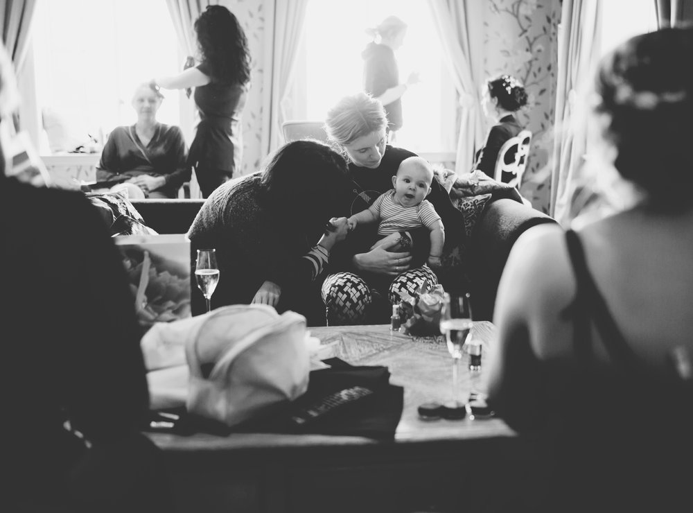 bridesmaids holding the baby - documentary wedding photographer in lancashire