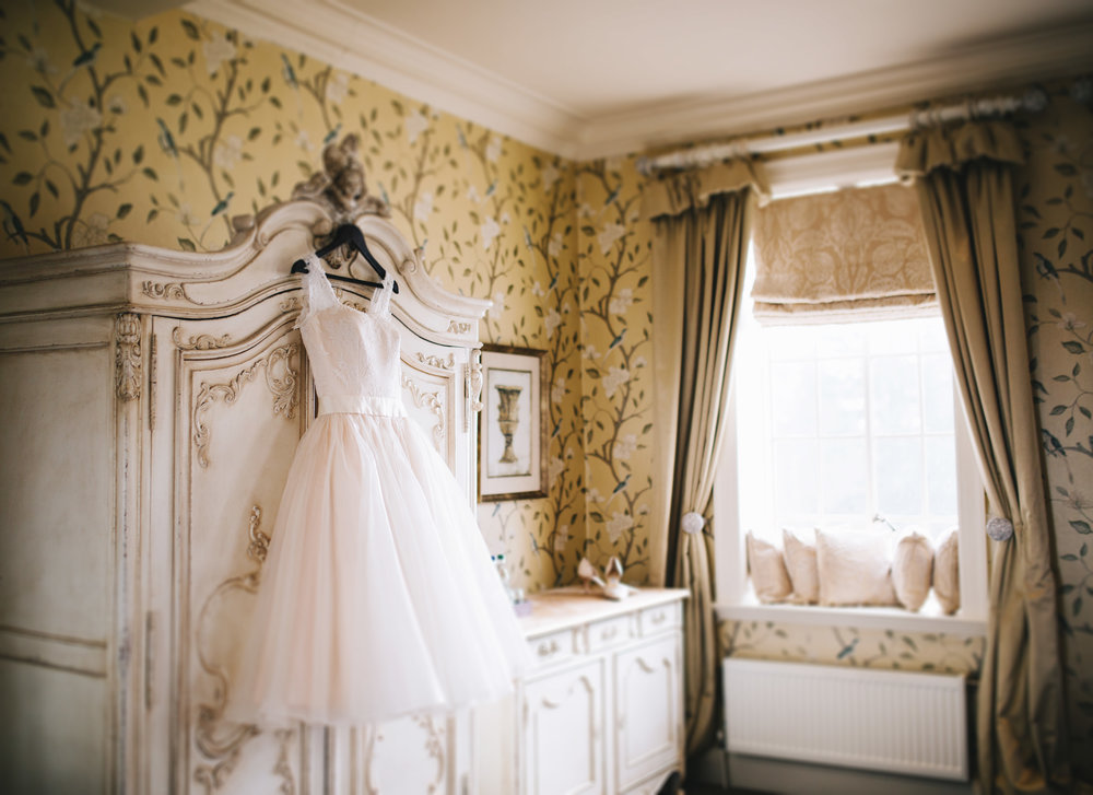 Eaves Hall wedding photography - dress and shoes hanging up