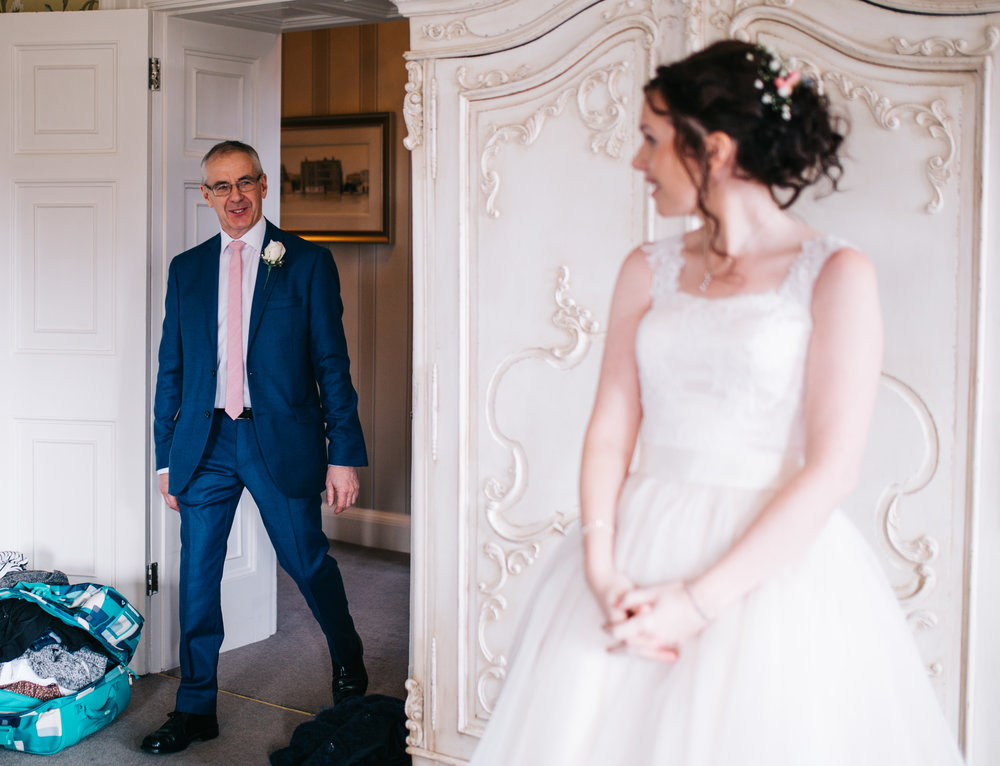 bride dad arrives at the bridal suite