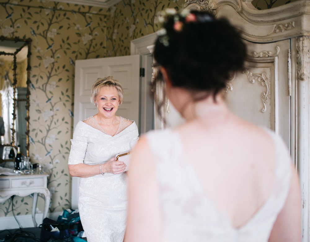 bride's mum sees her for the first time  - eaves hall wedding