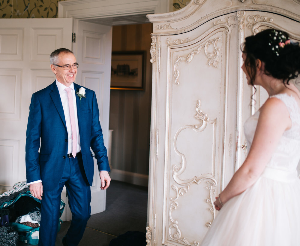 dad sees his daughter for the first time - wedding photography in Lancashire