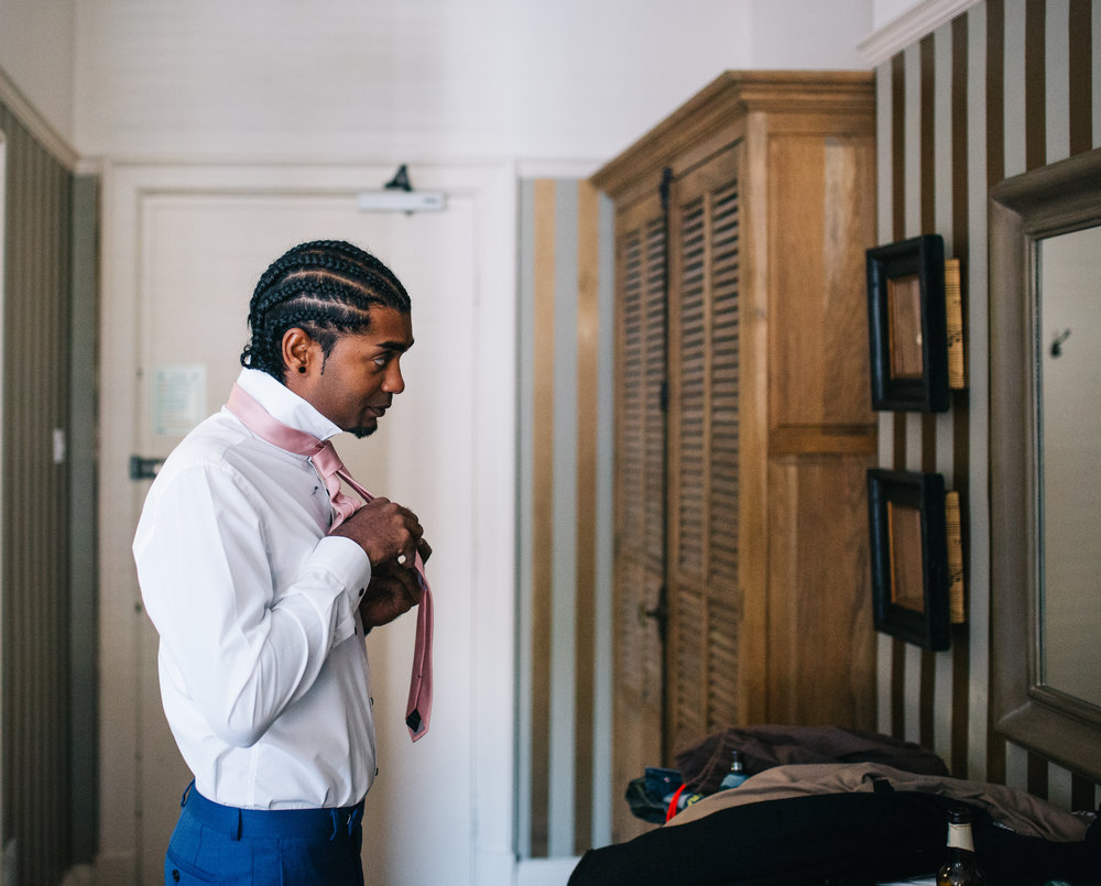 groom gets ready at eaves hall lancashire