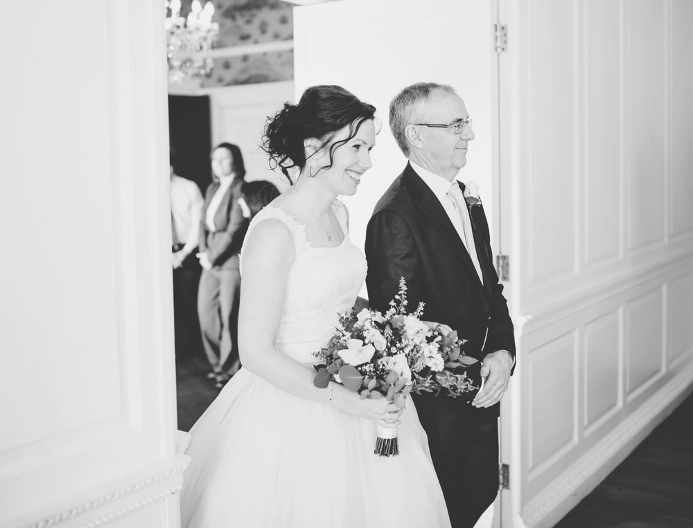 bride enters the wedding ceremony at eaves hall