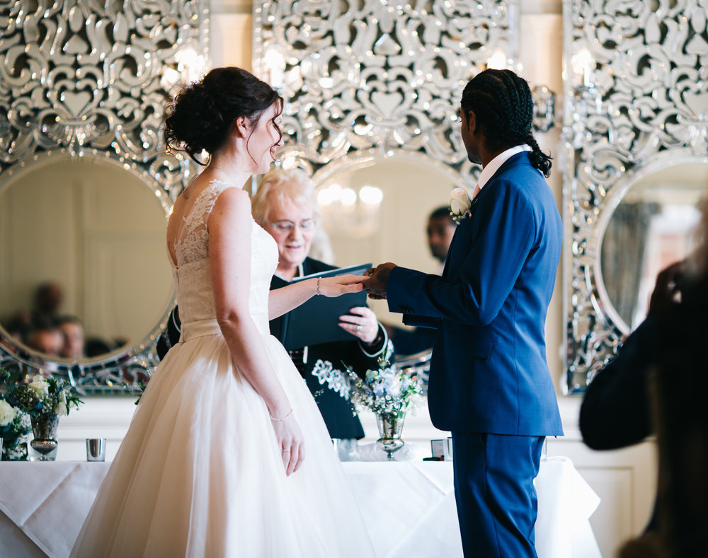 north west wedding photographer at eaves hall - bride and groom exchange vows