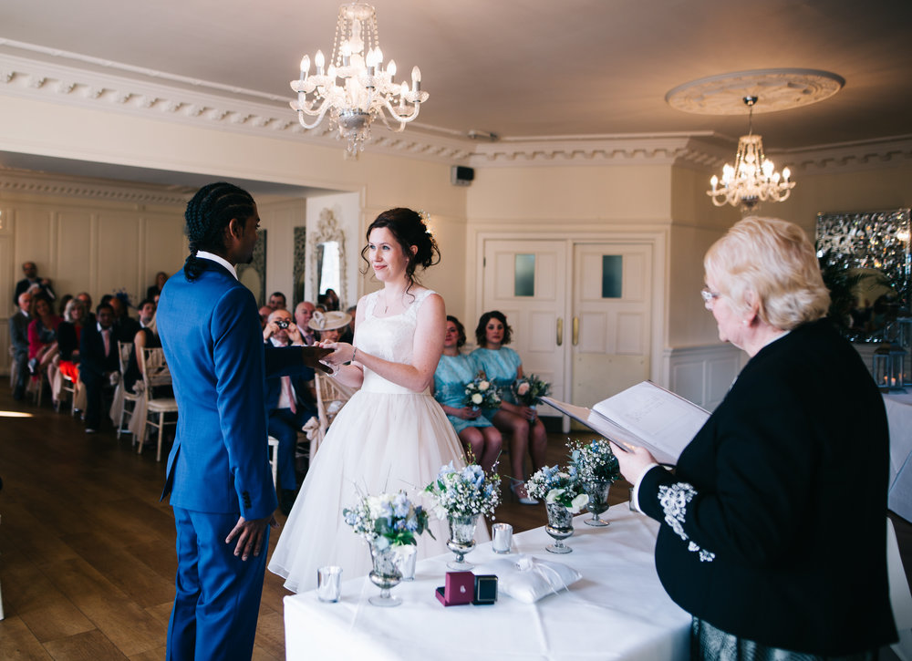 exchanging vows in eaves hall wedding ceremony