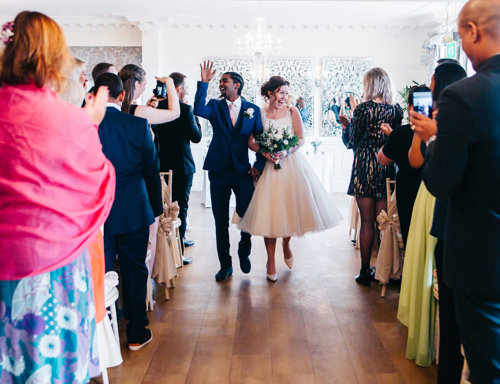 emotions and laughter as bride and groom walk down the aisle