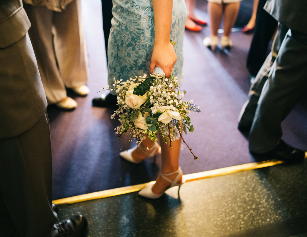modern adn artistic wedding photography in lancashire - bouquet held by the bridesmaids