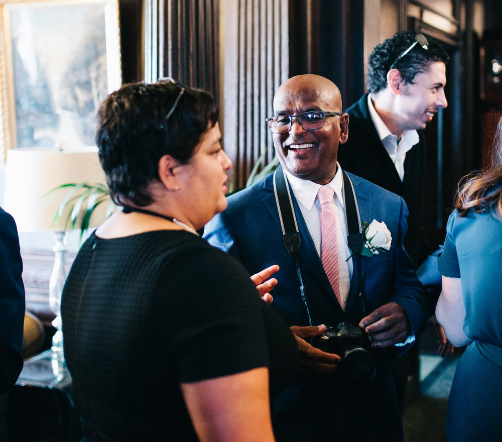 guests laughing during the wedding ceremony at eaves hall
