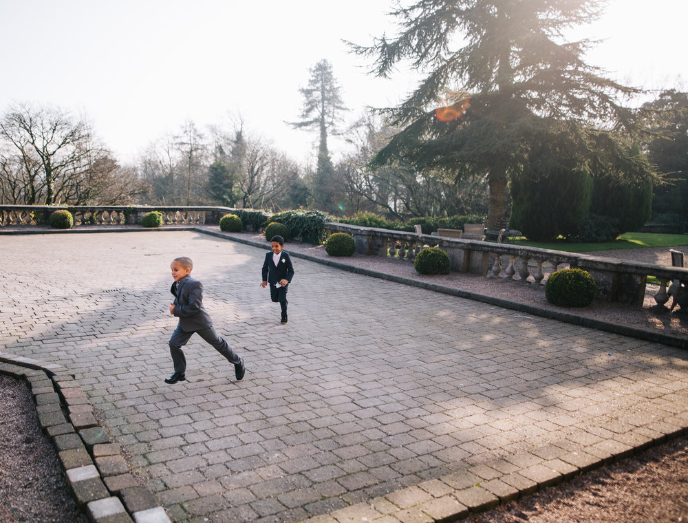 children playing in the sunshine outside eaves hall