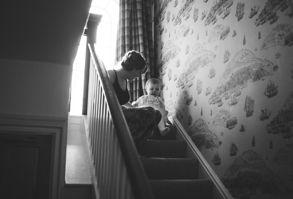 little bridesmaid comes down the stairs