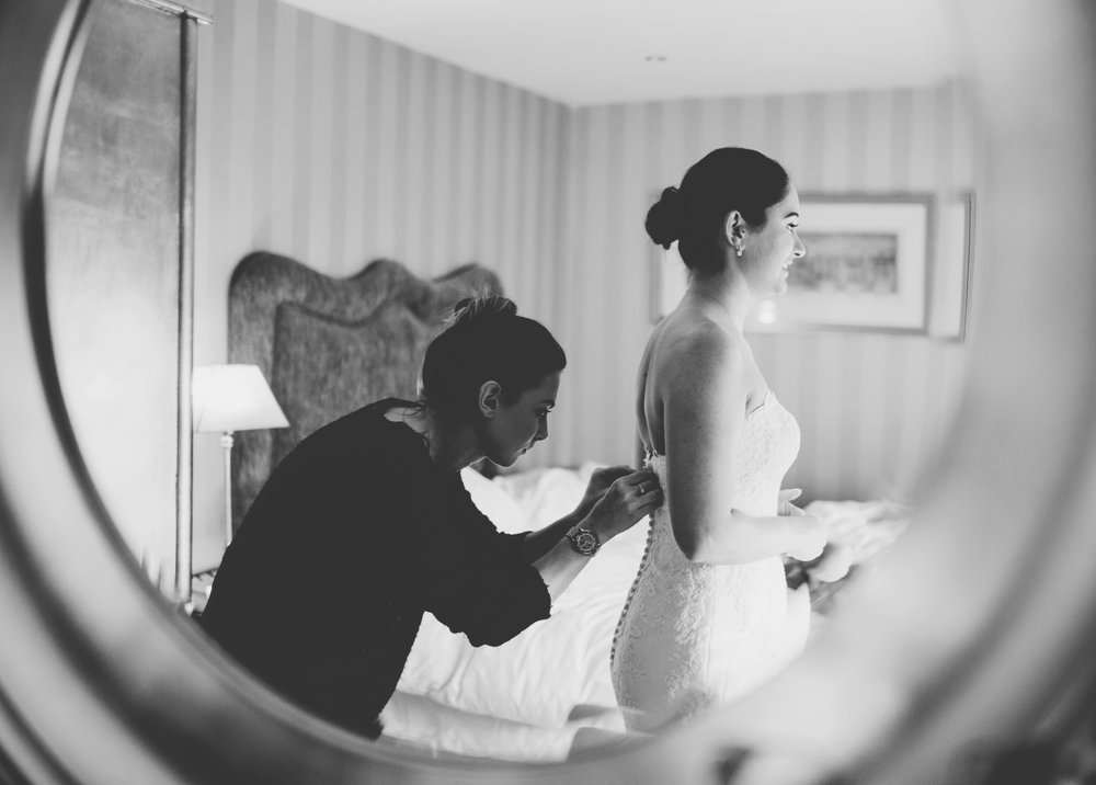 reflection of the bride in the mirror - documentary wedding photography lancashire