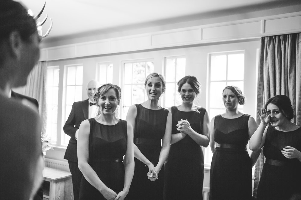 bridesmaids reactions to seeing the bride in her dress - creative and natural wedding images
